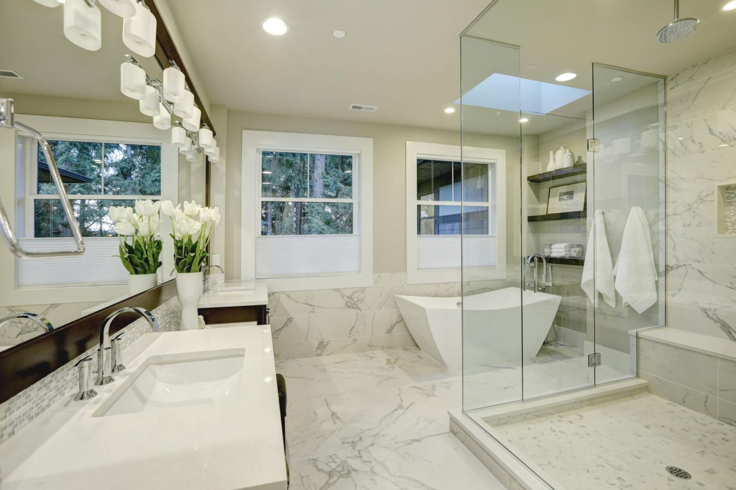 70308431 - amazing white and gray marble master bathroom with large glass walk-in shower, freestanding tub and skylights on the ceiling. northwest, usa